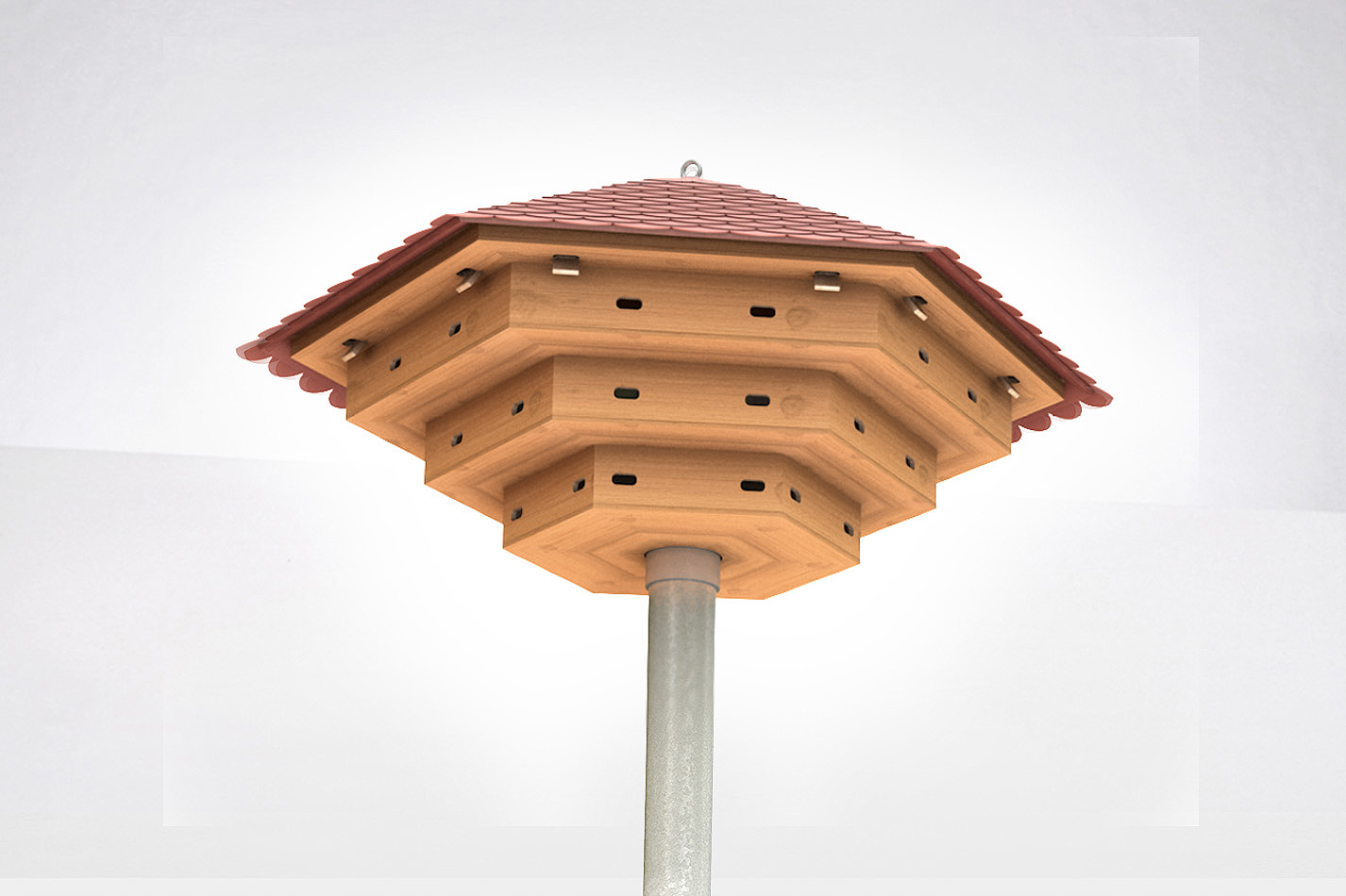 Ein dreistöckiges Mauerseglerhaus aus Holz auf einem Stahlmast